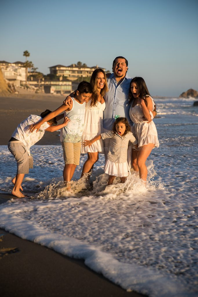 Beach Family Photo Blooper gets hit by Ocean Wave
